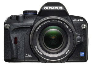 The Olympus E-450, a dSLR camera, weighs less than a pound.