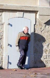 Man casts shadow in front of door.